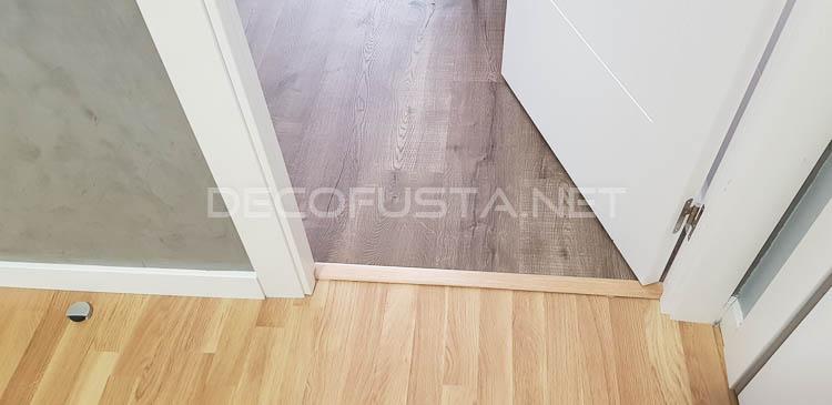 Pletinas o pasos de puerta en el mismo color que el parquet